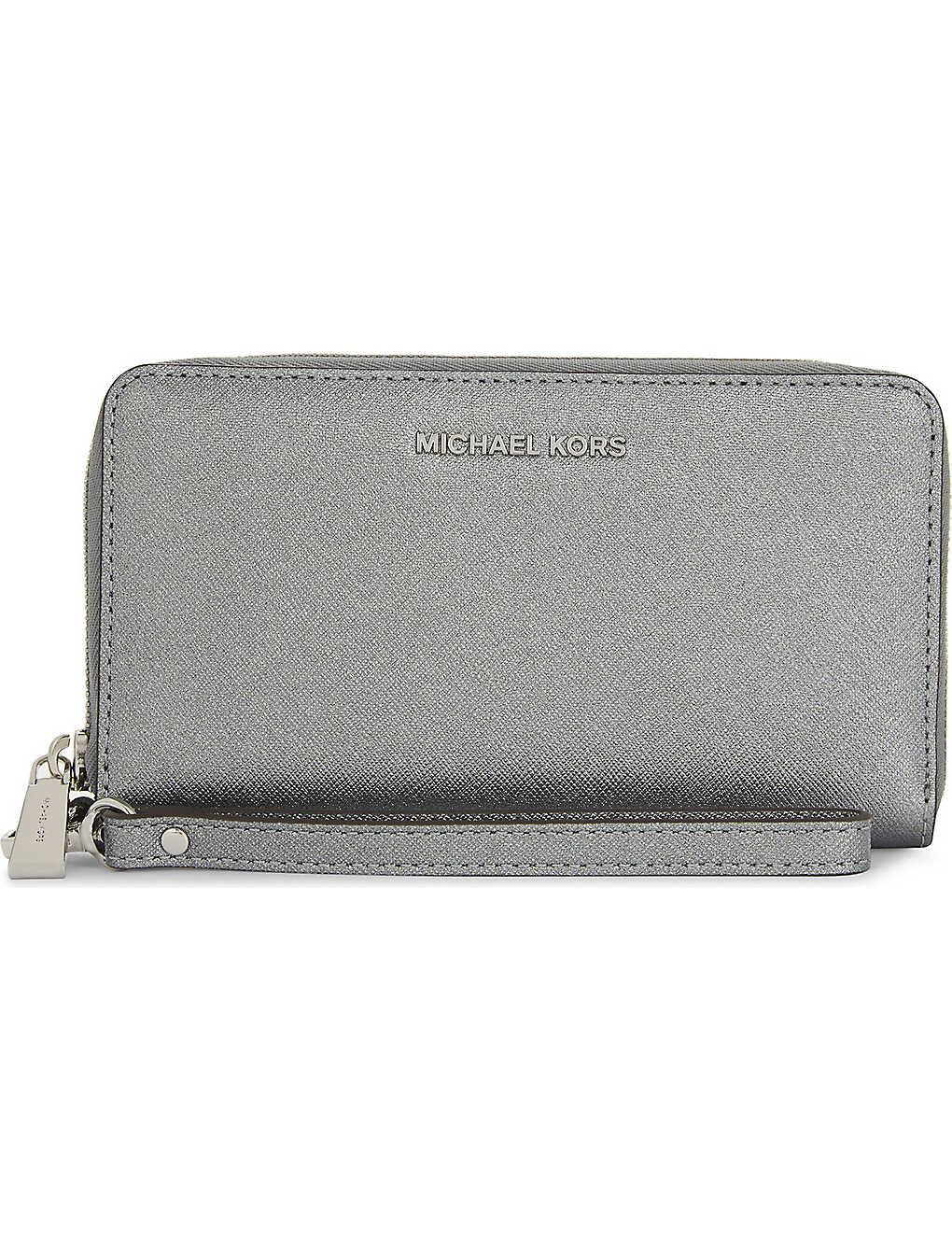 MICHAEL MICHAEL KORS - Jet set travel leather purse   Selfridges.com 1c95fa3e5d