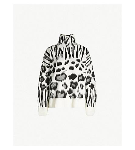 d6903cd14080b ... TOPSHOP Zebra-print brushed-knit jumper. PreviousNext