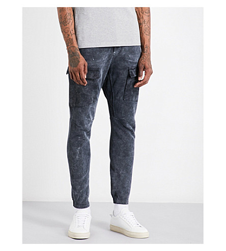 STONE ISLAND Tapered regular-fit mid-rise cotton-blend trousers (Nero
