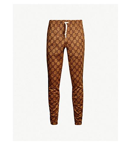 GUCCI Logo-intarsia stretch-jersey track pants (Brown