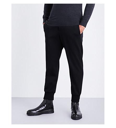 NEIL BARRETT Dropped-crotch neoprene trousers (Black