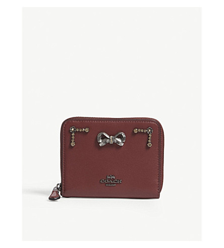 437981da319c ... COACH Coach x Selena small zip-around wallet with crystal embellishment  (Gm wine. PreviousNext