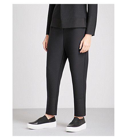 ISSEY MIYAKE Cosmic Ripple tapered pleated trousers (Black