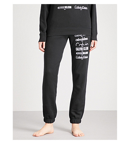 CALVIN KLEIN Multi logo-print stretch-jersey jogging bottoms (001+black