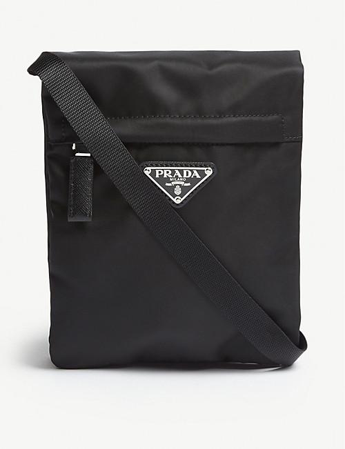 d832a00deef PRADA - Logo nylon cross-body pouch | Selfridges.com