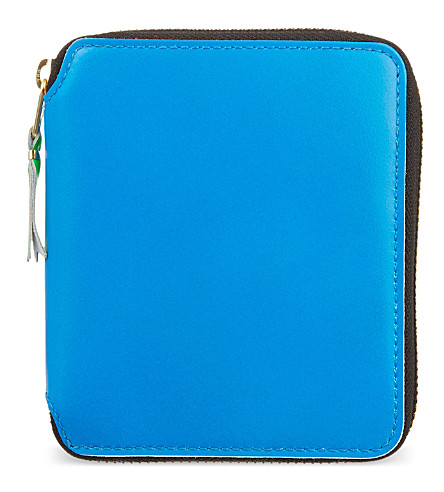 COMME DES GARCONS Superfluorescent zip around leather wallet (Blue