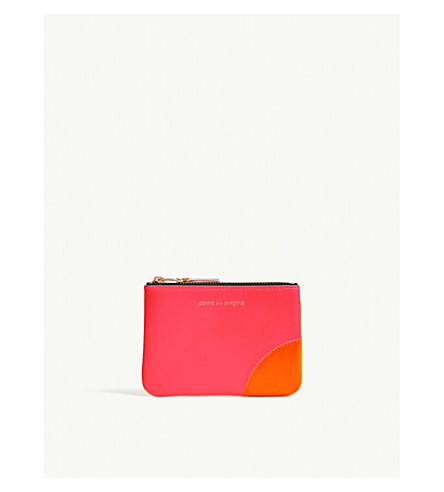 COMME DES GARCONS Super-fluorescent leather pouch (Pink yellow