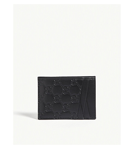 GUCCI Embossed GG leather card holder (Black