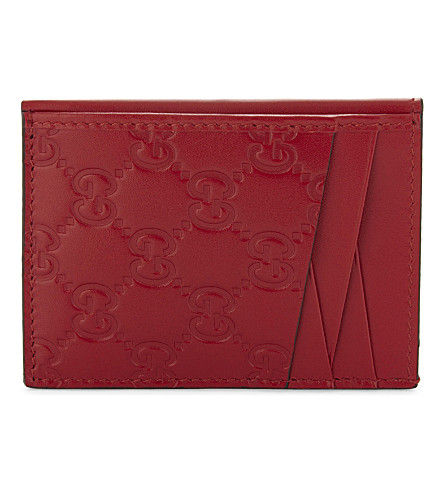 GUCCI Embossed GG leather card holder (Red