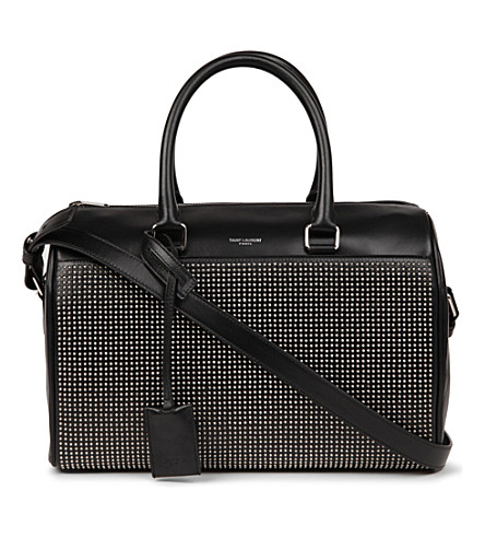 SAINT LAURENT Studded leather duffle bag (Noir