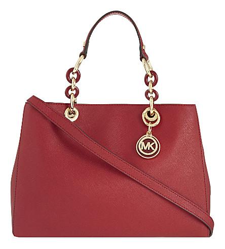 fdcde2db184a ... MICHAEL MICHAEL KORS Cynthia medium Saffiano leather satchel (Cherry.  PreviousNext