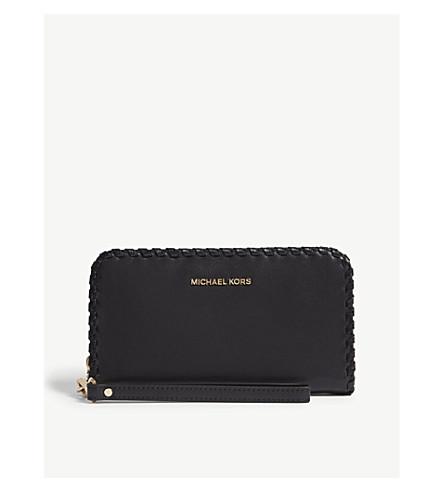 ... MICHAEL MICHAEL KORS Whipstitch leather wristlet wallet (Black.  PreviousNext bda8845216