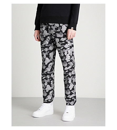 A BATHING APE Reflection tapered camouflage-print cotton-blend trousers (Black