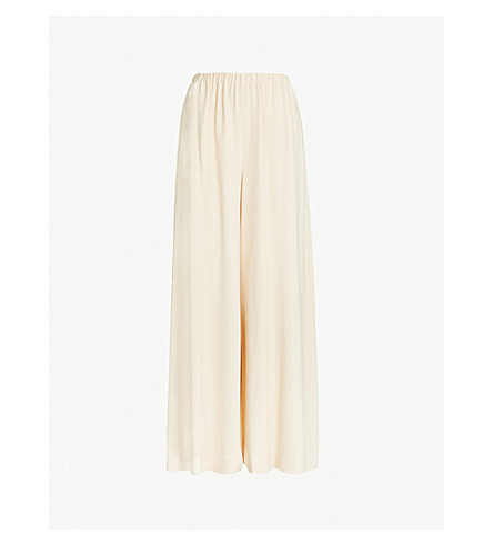 THE ROW High-rise wide crepe trousers (Butter