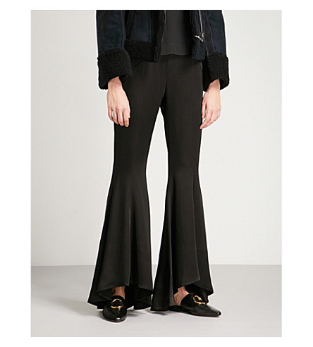 ARJE Flared crepe trousers (Black