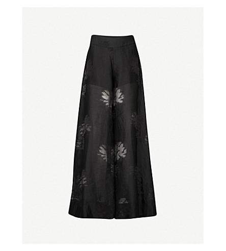 ARJE Flared wide-leg devoré trousers (Black