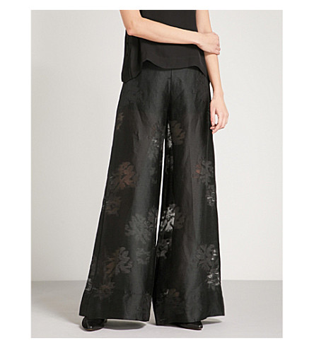 ARJE Flared wide-leg devoré trousers (Black