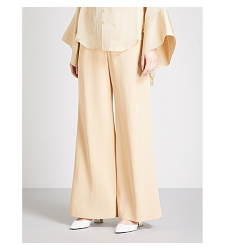 ARJE Obi flared high-rise trousers (White+gold
