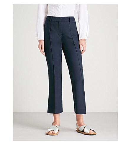 KHAITE Marianna flared high-rise woven trousers (Navy