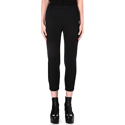 PLEATS PLEASE ISSEY MIYAKE Tapered pleated trousers (Black