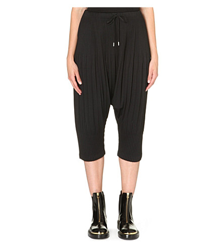 PLEATS PLEASE ISSEY MIYAKE Pleated drawstring harem trousers (Black