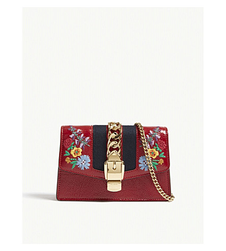 GUCCI Sylvie floral embroidered leather clutch (Red
