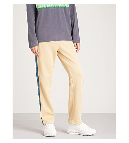 STUSSY Logo tape sports-jersey jogging bottoms (Khaki