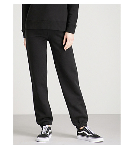 STUSSY Logo-embroidered relaxed-fit cotton-blend jogging bottoms (Black