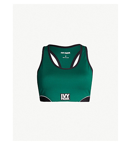 IVY PARK Cutout logo-print stretch-jersey sports bra (Forest green