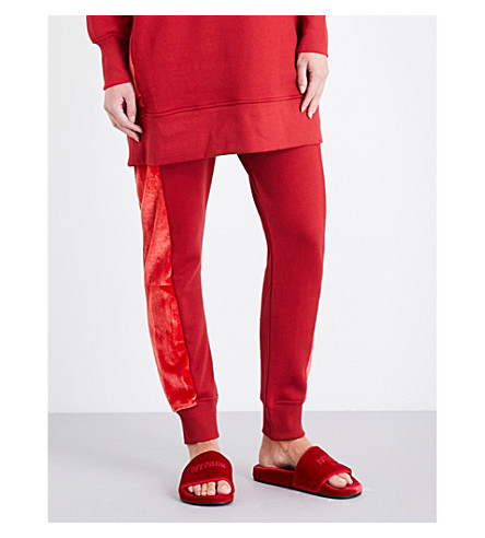 IVY PARK Velvet-side slouchy-fit jersey jogging bottoms (Chilli+red