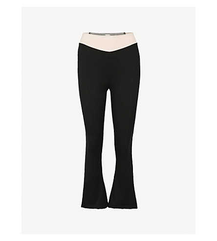 SAPOPA Stella panelled flared stretch leggings (Pink+black