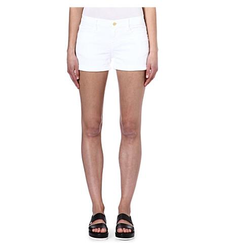 FRAME Stretch-denim cut-off shorts (Blanc