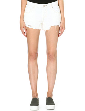 FREE PEOPLE Sharkbite distressed denim shorts