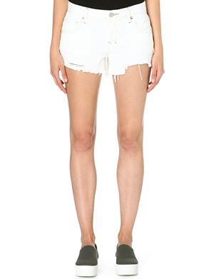 FREE PEOPLE Sharkbite distressed denim shorts