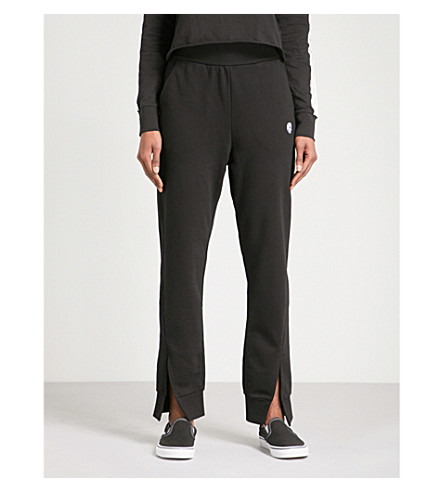 CHEAP MONDAY Haste tapered mid-rise cotton-blend jogging bottoms (Black