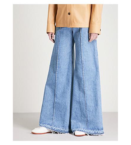 KSENIA SCHNAIDER Wide Frayed Hem high-rise jeans (Medium+blue