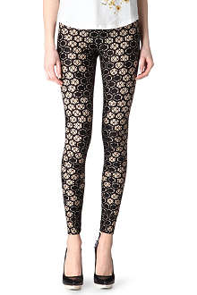 ALEXANDER MCQUEEN Honeycomb-printed leggings
