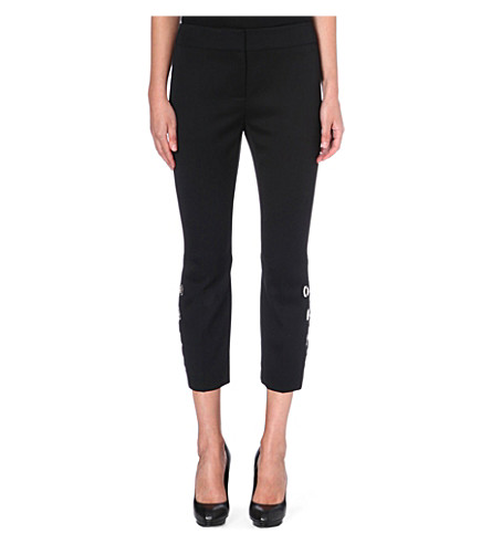ALEXANDER MCQUEEN Eyelet-detail cropped wool trousers (Black