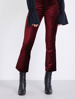 Woman wearing red velvet jeans