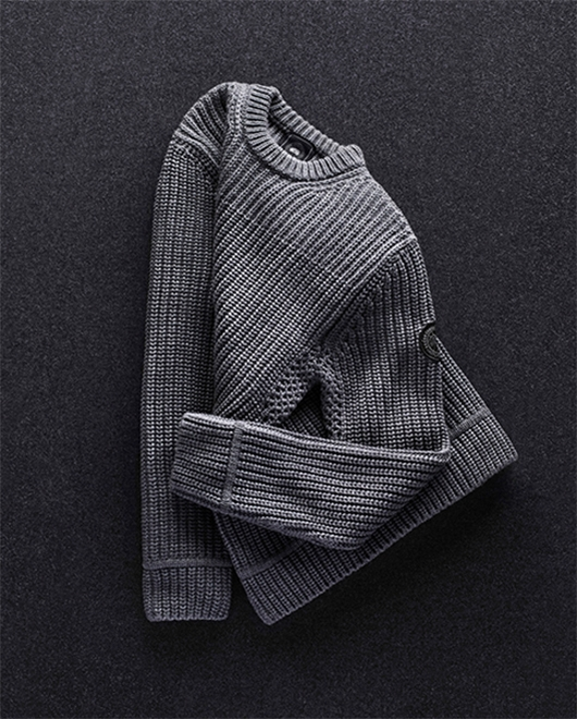 A men's grey knitted sweater