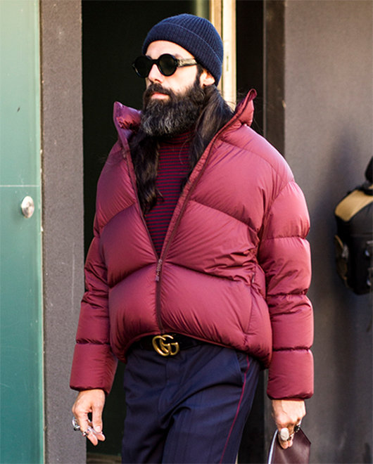 A street-style image of a man in a puffer jacket