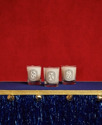 Three Diptyque candles