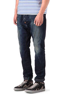 VIVIENNE WESTWOOD Asymmetric loose-fit tapered jeans