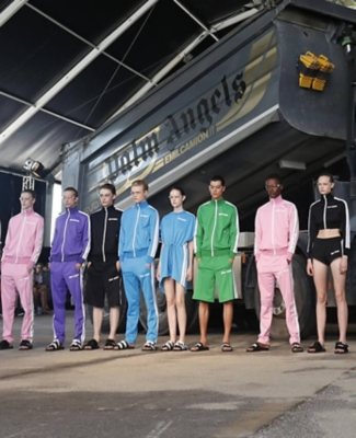 Men and women lined up in colourful Palm Angels streetwear