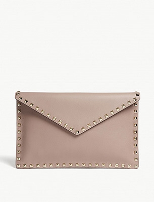 A pale pink clutch bag
