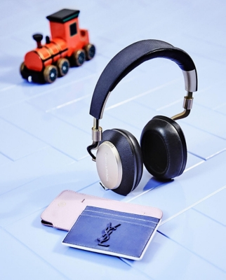 A pair of headphones and leather card and phone holder