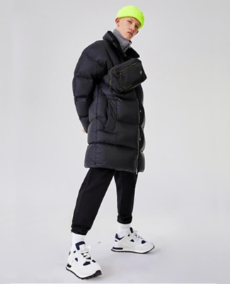 Acne Studios puffer jacket worn with Magic Stick jacket and Maison Margiela joggers and sneakers