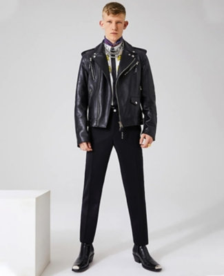 Alexander McQueen leather biker jacket worn with Versace printed shirt