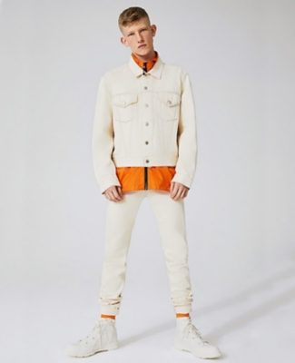 Helmut Lang denim jacket and jeans worn with orange Stussy jacket and Heron Preston socks