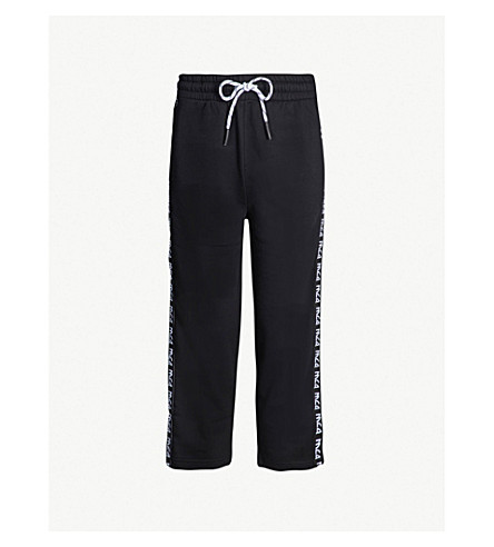 MCQ ALEXANDER MCQUEEN Cropped logo cotton-jersey jogging bottoms (Darkest black